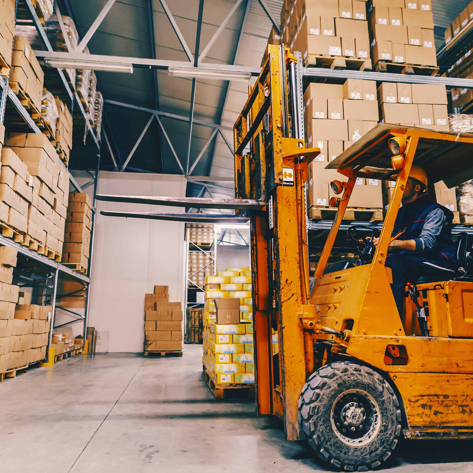 Warehouse with forklift operator